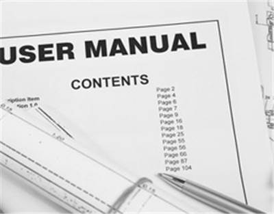 Picture of a user manual and a pen